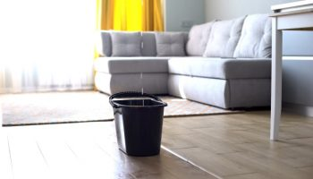 bucket-water-damage-livingroom